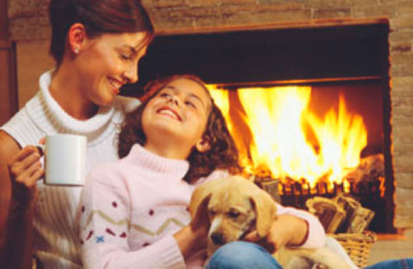 Mother and Daughter by Fireplace